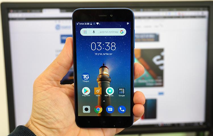 טלפון Redmi Go ביד המשתמש
